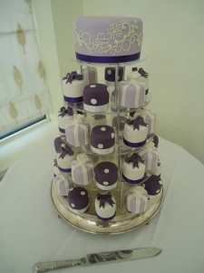 purple white cup cakes tower