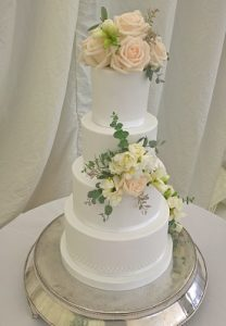 We have just received another client testimonial for another of our Four Tier Wedding Cakes.